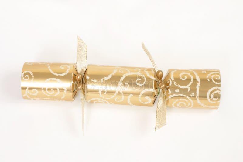 guld- julsmällare arkivfoto