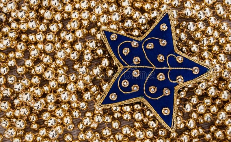 Guld- julstjärna royaltyfri foto