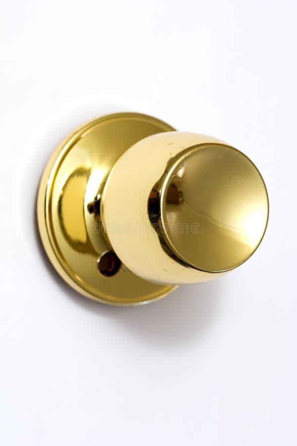 guld- knopp för dörr royaltyfri foto