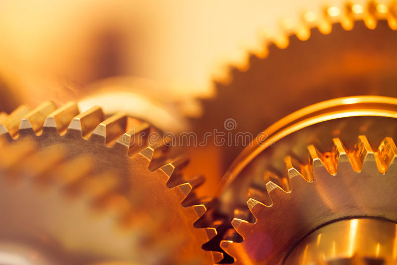 Guld- kugghjulhjul royaltyfri foto