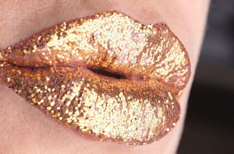 guld- kyss arkivbild