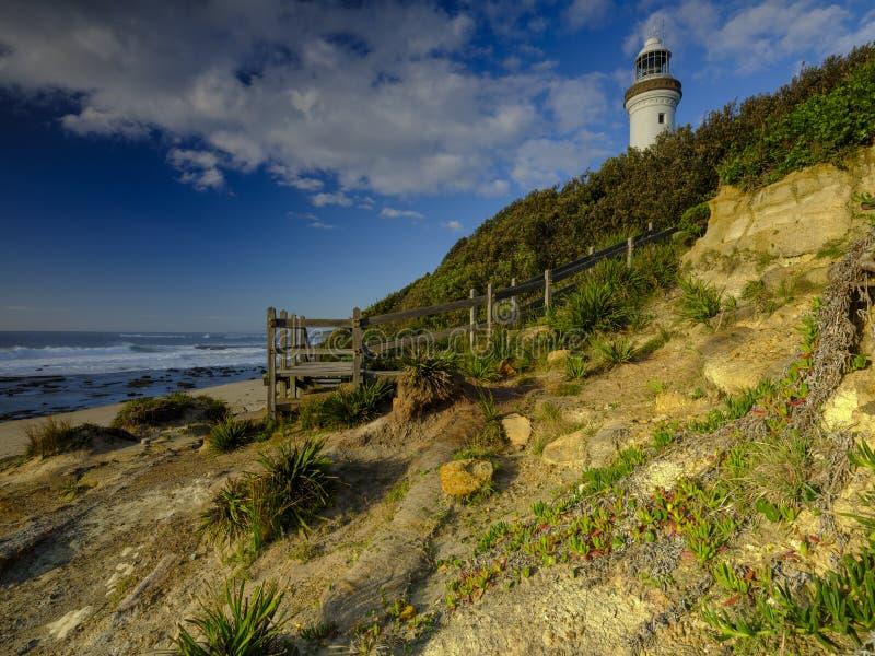 Guld- ljus f?r sommarmorgon p? Norah Head Light House, central kust, NSW, Australien arkivbild