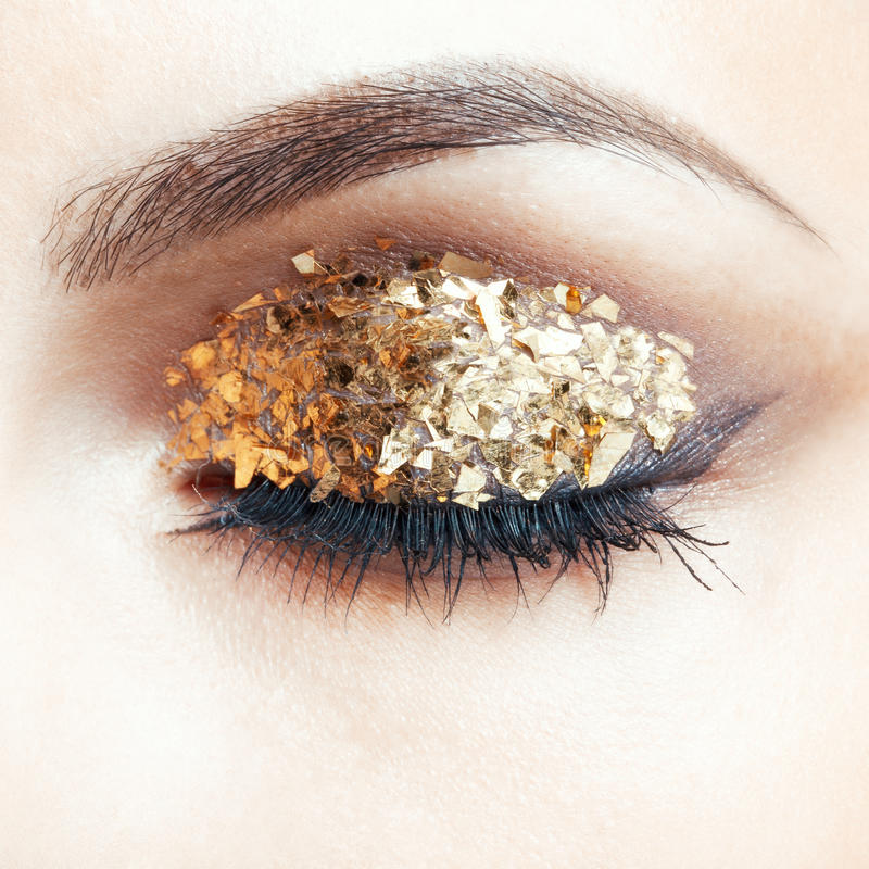 guld- makeup för öga fotografering för bildbyråer