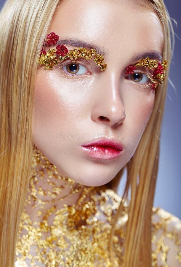 guld- makeup royaltyfri foto