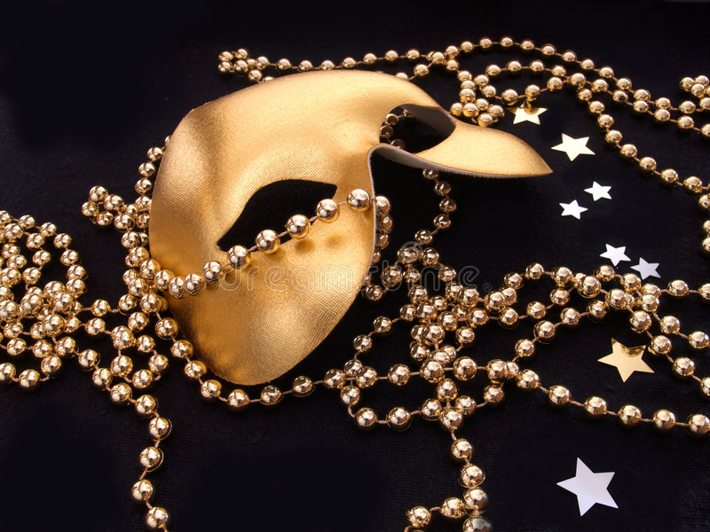 guld- maskering arkivbilder