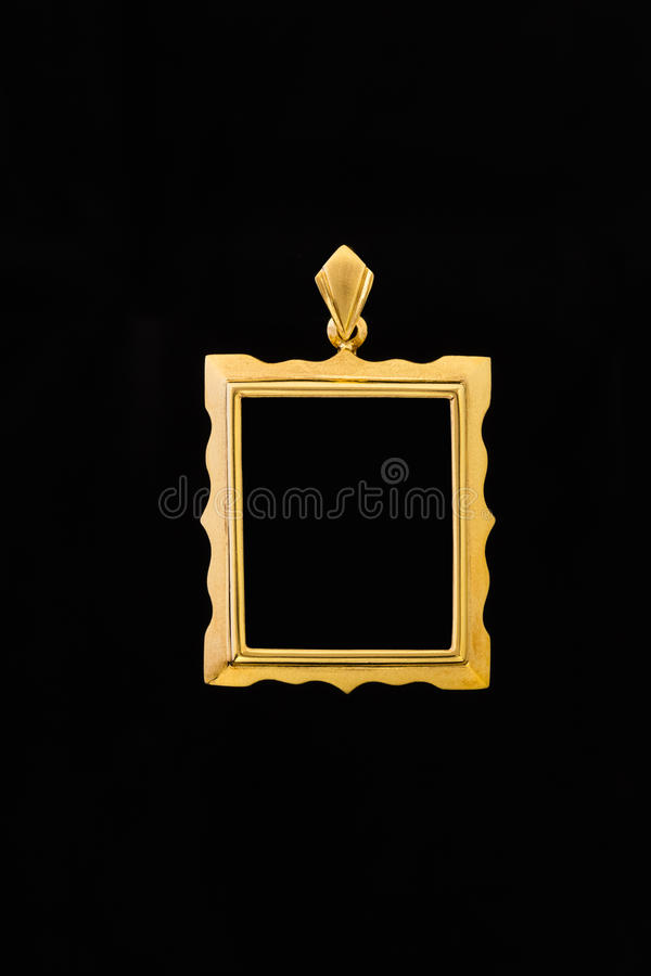 Guld- medaljongramhänge arkivfoton