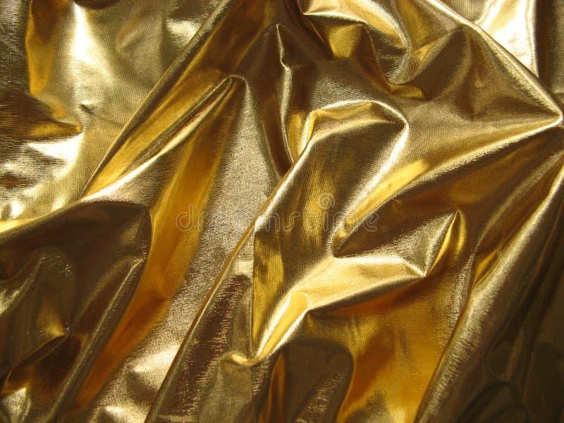 guld- metalliskt för tyg royaltyfri fotografi