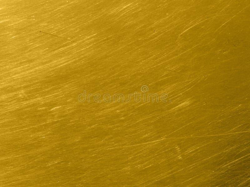 Guld- metalltextur med runda skrapor royaltyfri illustrationer