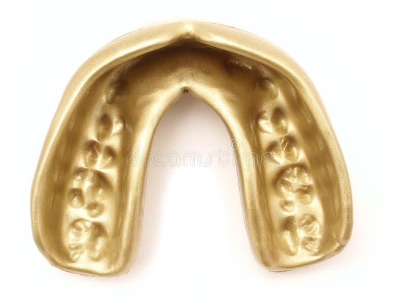guld- mouthguard royaltyfria foton