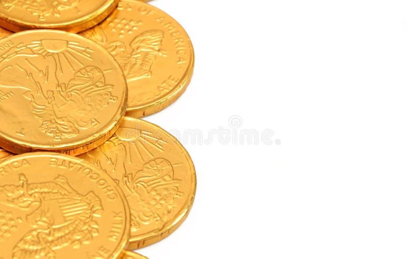 Guld- mynt för choklad arkivbilder