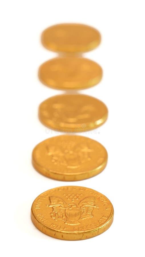 Guld- mynt för choklad royaltyfria bilder