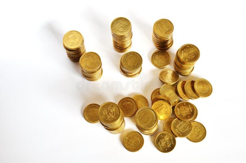 Guld- myntar besparingar royaltyfri bild