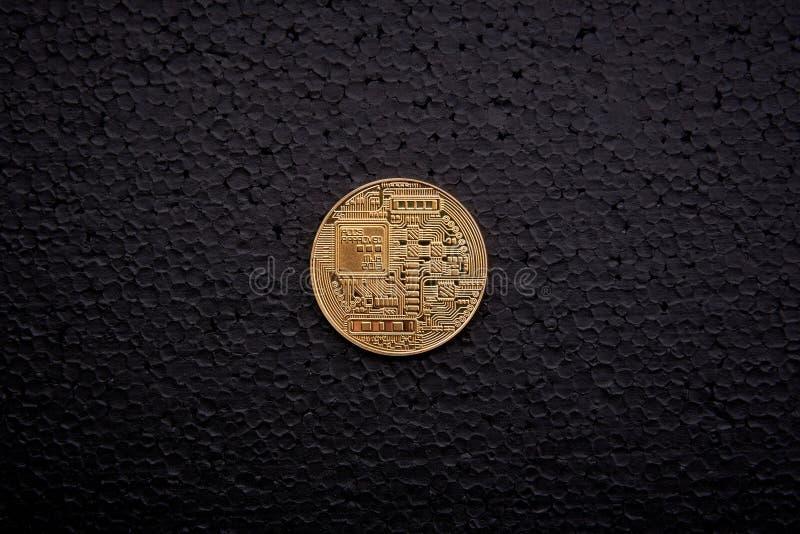 Guld- myntbitcoin arkivfoto