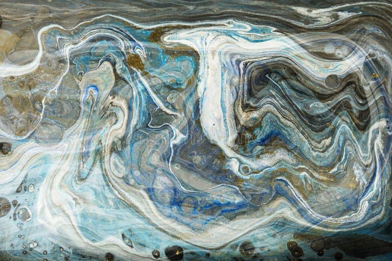 Guld och blå marmorera texturdesign Guld- marmormodell Fluid konst royaltyfria bilder