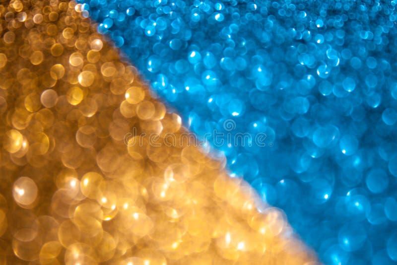 Guld- och blå mousserande dubbel bakgrund royaltyfria foton