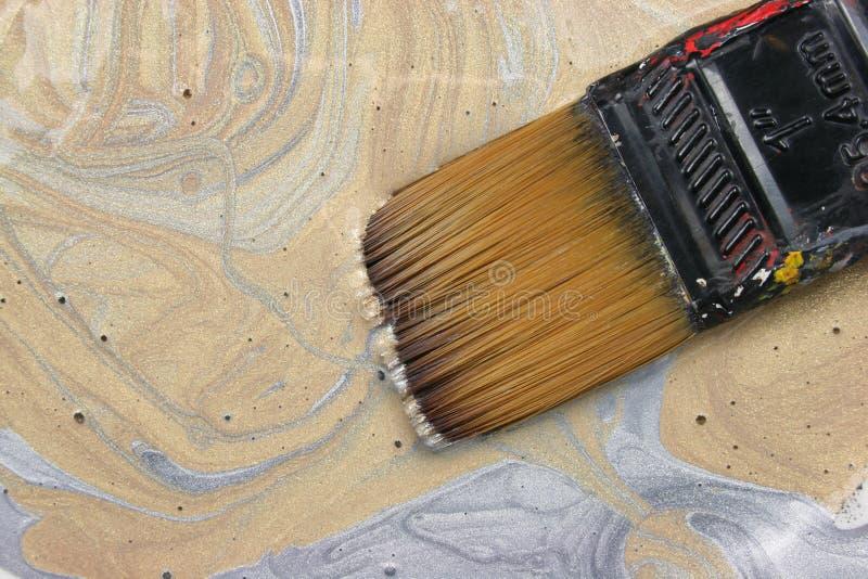 Guld- och försilvra målar royaltyfri foto