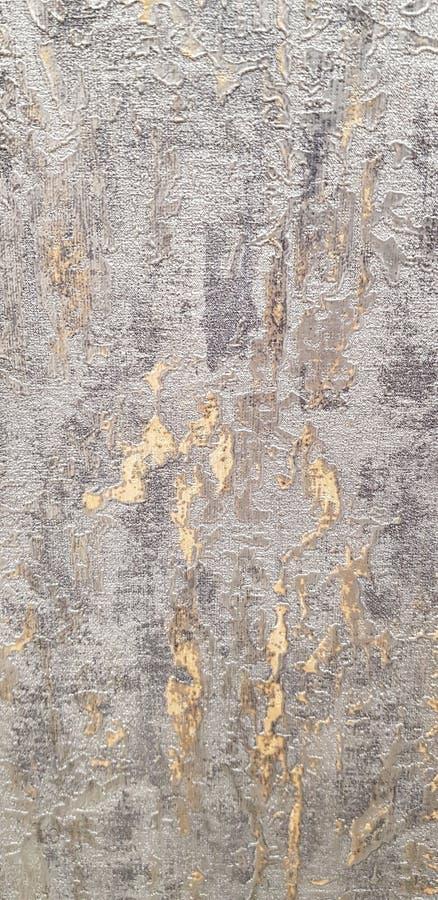 Guld- och grå dekorativ bakgrundstextur royaltyfri foto