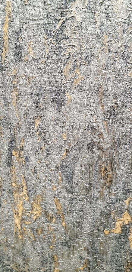 Guld- och grå dekorativ bakgrundstextur royaltyfria foton