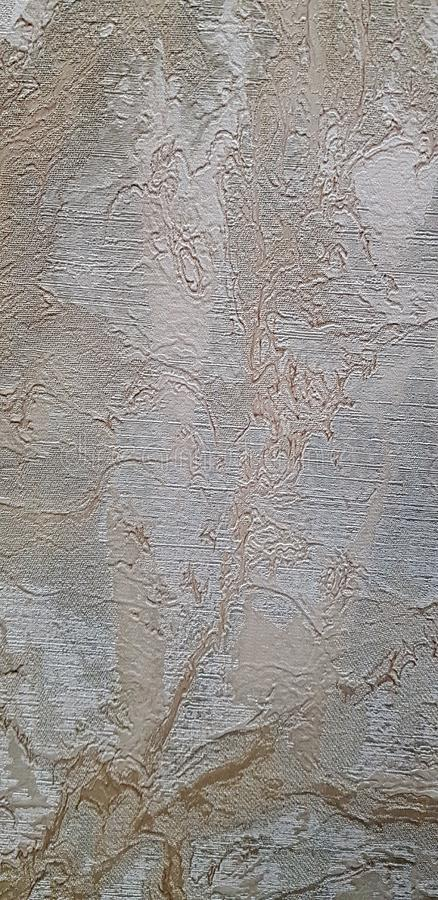 Guld- och grå dekorativ bakgrundstextur arkivbild