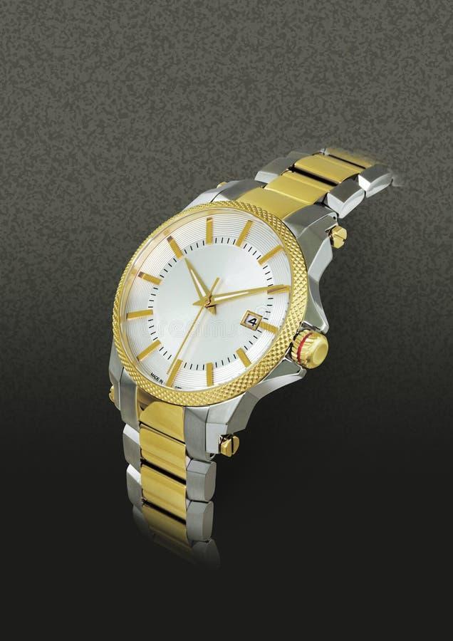 Guld- och vitt armbandsur royaltyfria foton