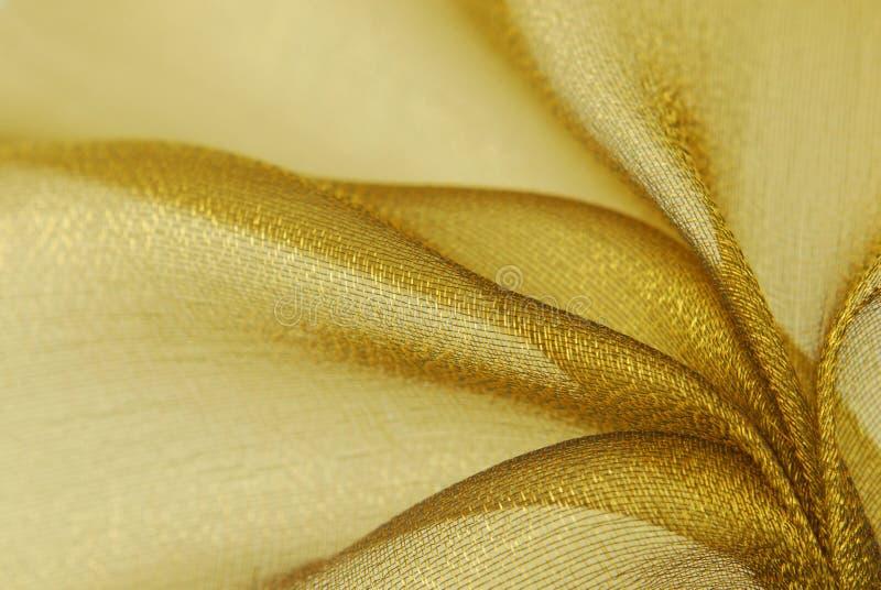 guld- organzatextur för tyg arkivfoto