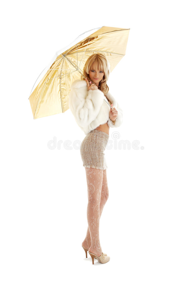 guld- paraply för flicka royaltyfria bilder