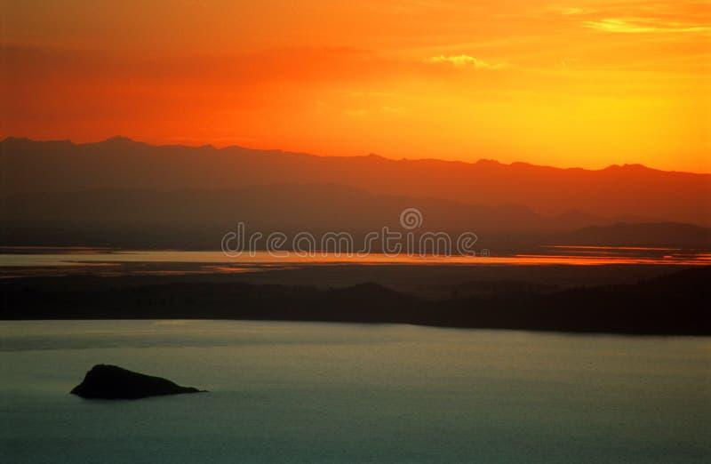 guld- peru solnedgång royaltyfria foton