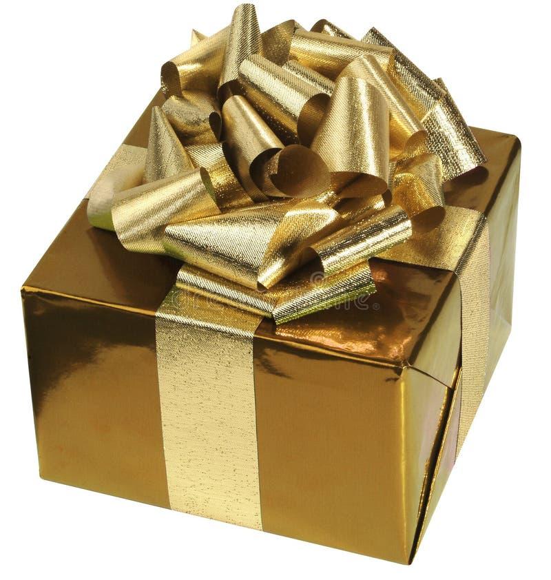 guld- present royaltyfri foto