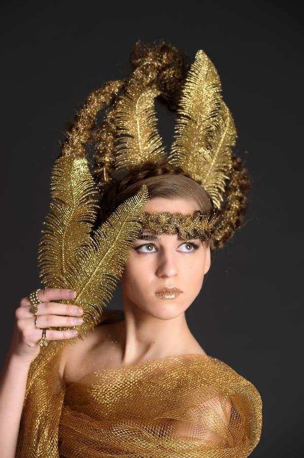 Guld- prinsessafe royaltyfria bilder