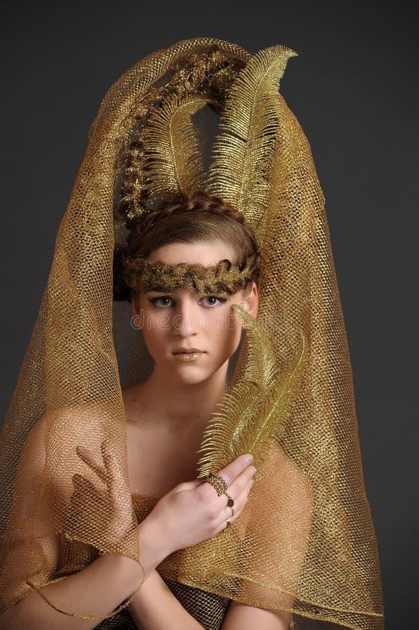 Guld- prinsessafe arkivbild