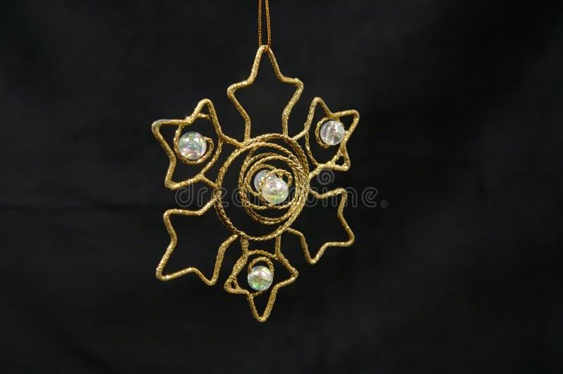 guld- prydnadstjärna för jul arkivfoto