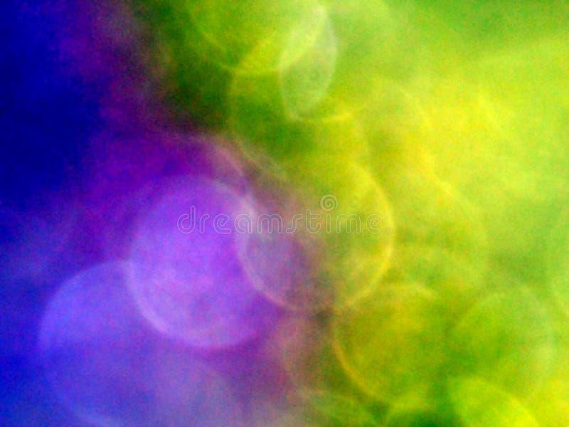 Guld- purpurf?rgad bakgrund och f?rgrik bokeheffekt royaltyfria foton