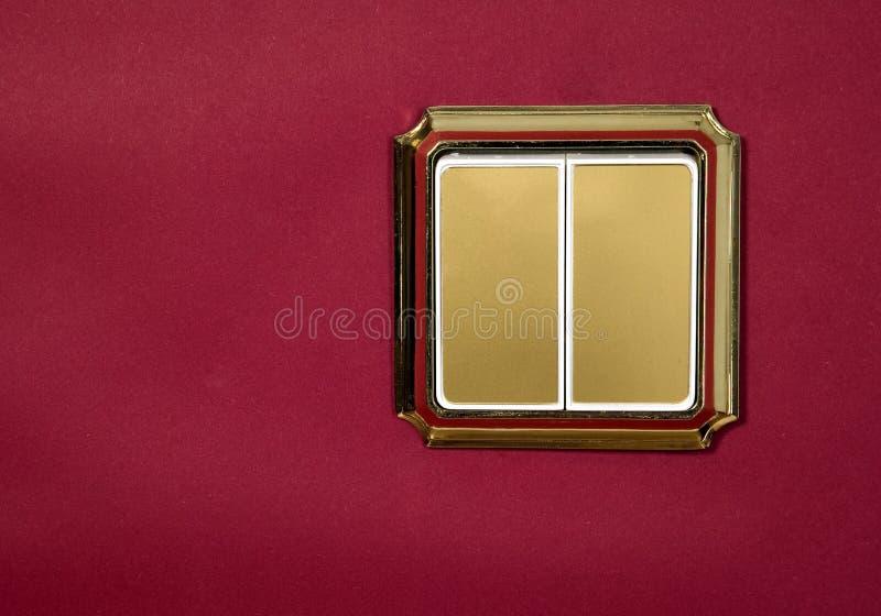 guld- röd stickkontakt för bakgrund royaltyfria bilder