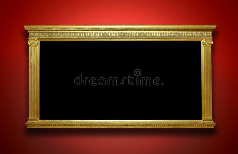 Guld- ram på galleriväggen royaltyfria bilder