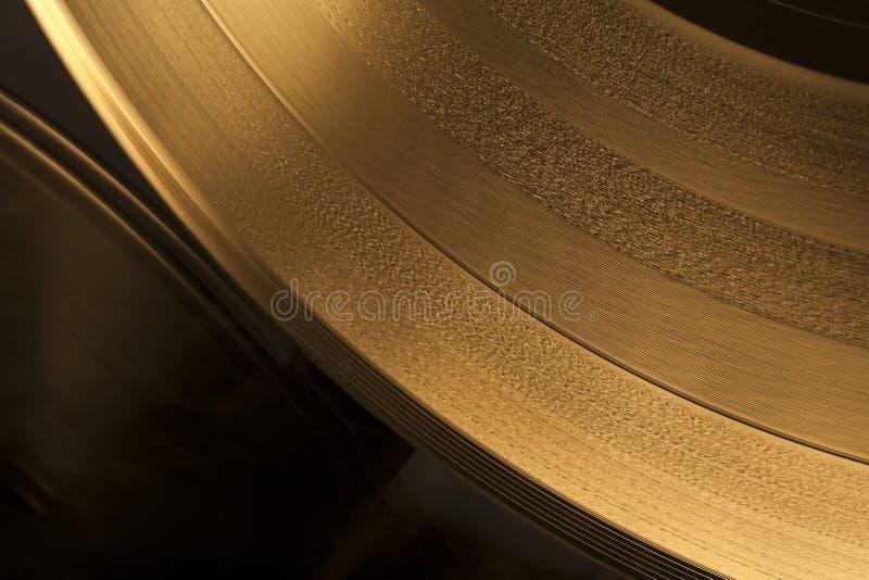 guld- registrerad vinyl royaltyfria bilder