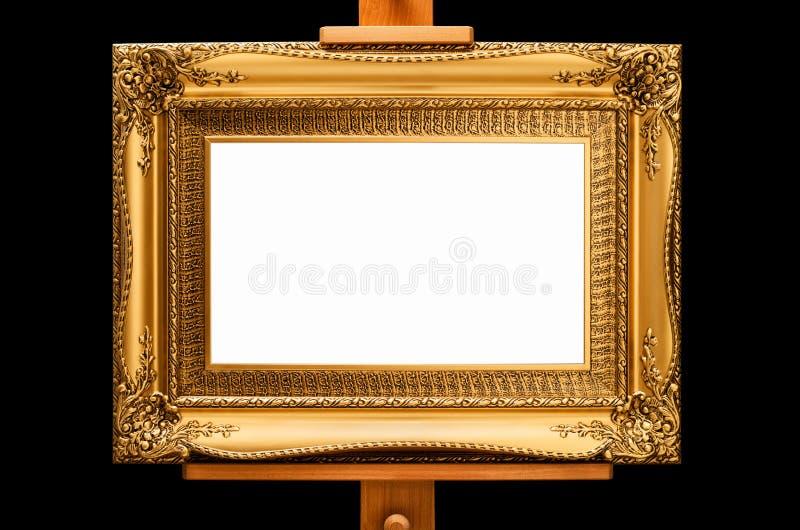 Guld- rokokoeraram på en staffli arkivfoto