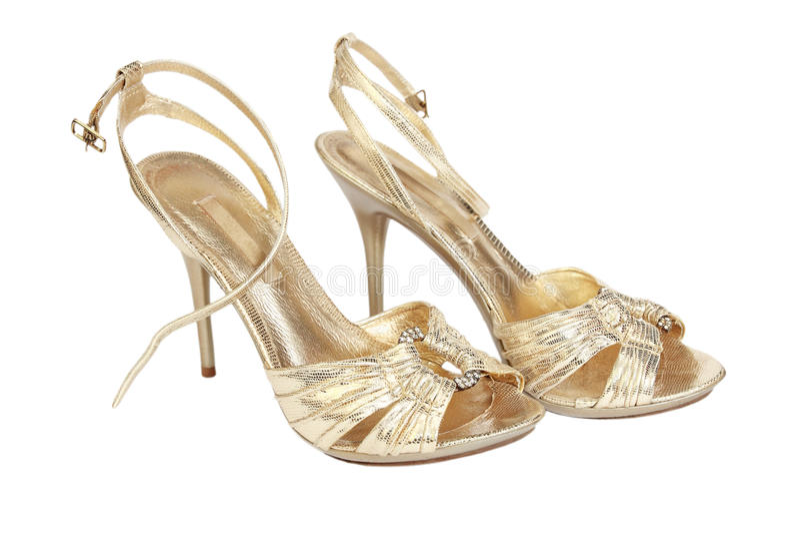 guld- sandals royaltyfri fotografi