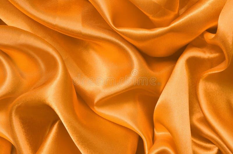 Guld- satäng för textur, siden- bakgrund arkivbilder