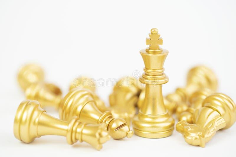 Guld- schackstycke royaltyfria bilder