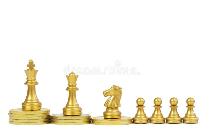 Guld- schackstycke arkivbilder