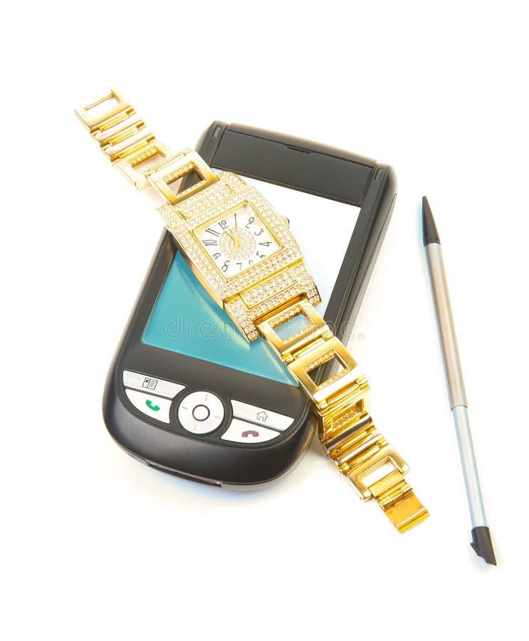 guld- smartphonewatch arkivbild