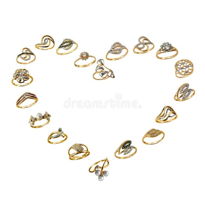 guld- smyckenförälskelseset royaltyfria foton