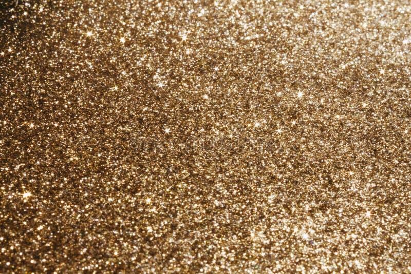 Guld- sparkling bakgrund arkivbild