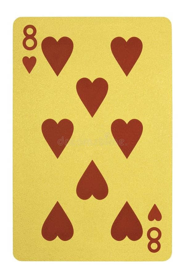 Guld- spela kort, åtta av hjärtor fotografering för bildbyråer