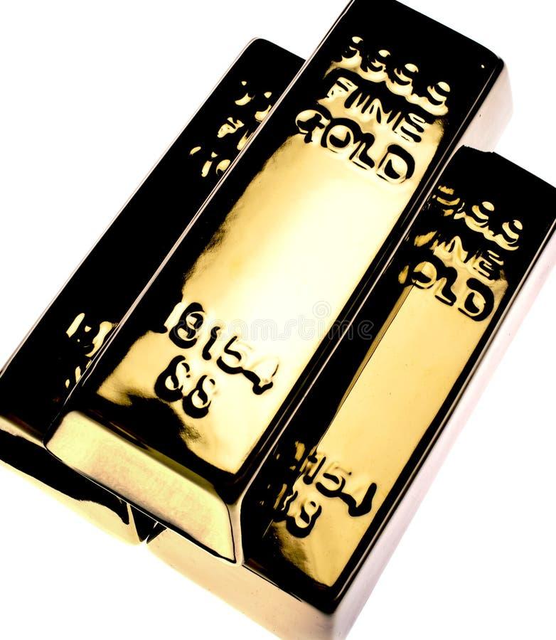 Guld- stänger arkivbilder