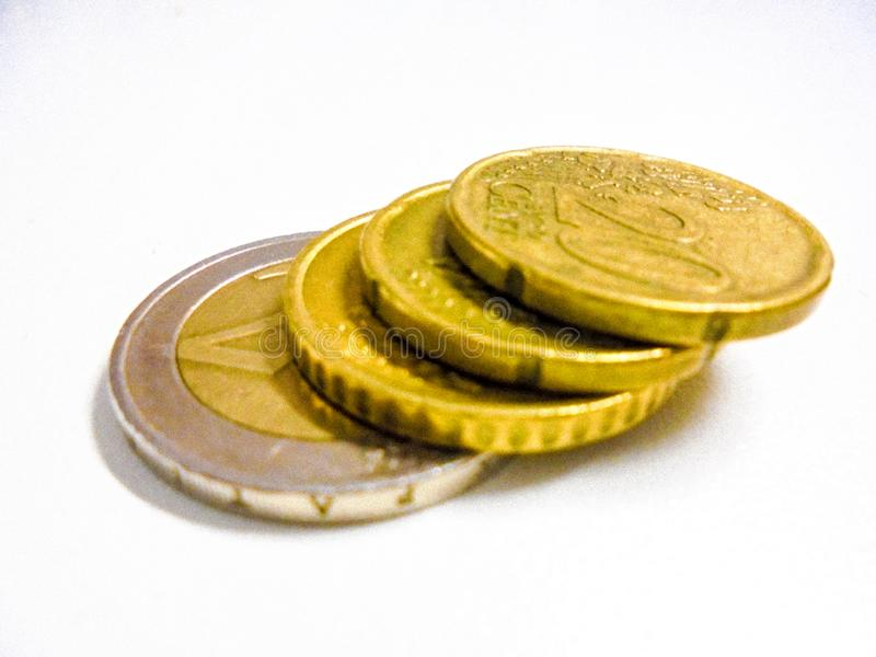 Guld- staplade pengar för euro mynt arkivfoto