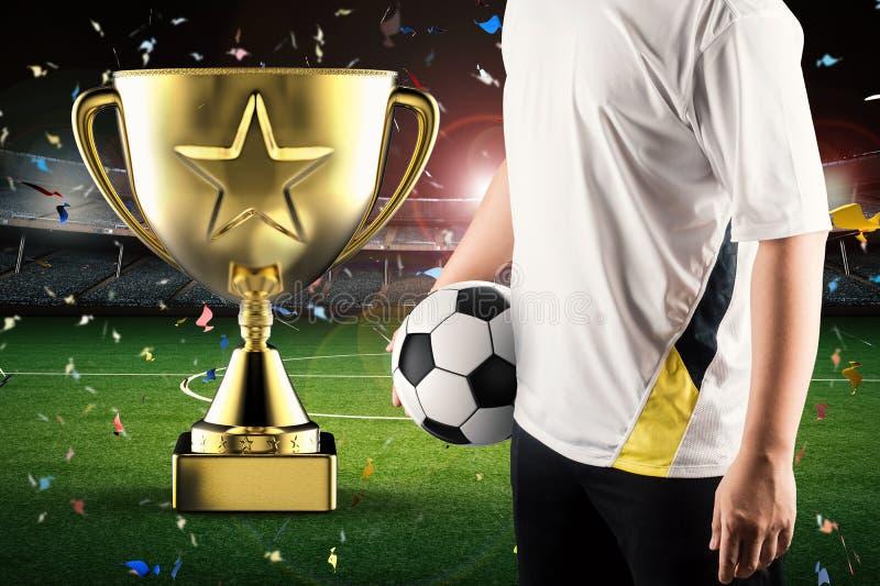 Guld- stjärnatrofé med fotbollspelaren royaltyfri fotografi