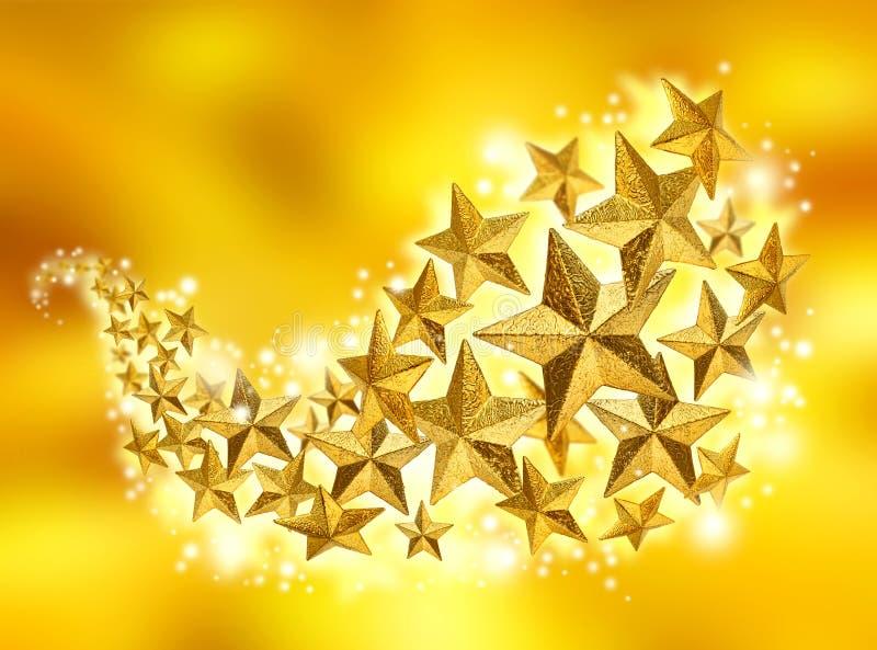 guld- stjärnor för berömflöde royaltyfri foto