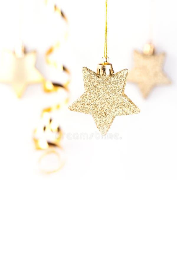 guld- stjärnor för jul arkivbilder