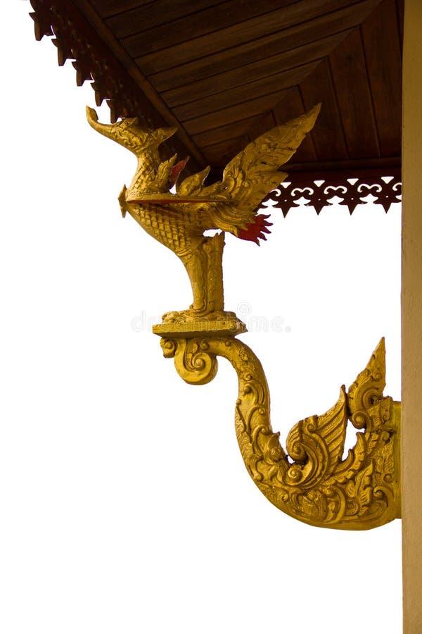 Guld- svanstatyer smyckade arkitekturen arkivbilder